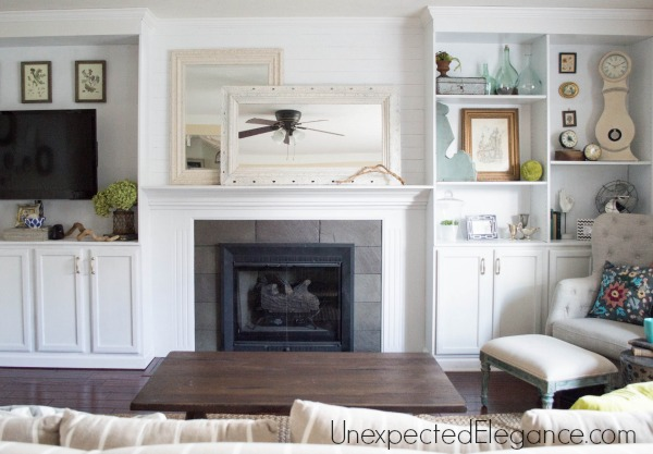 See how to transform you your living room with DIY fireplace built-ins! It completely changed the look of the space and made it feel bigger.