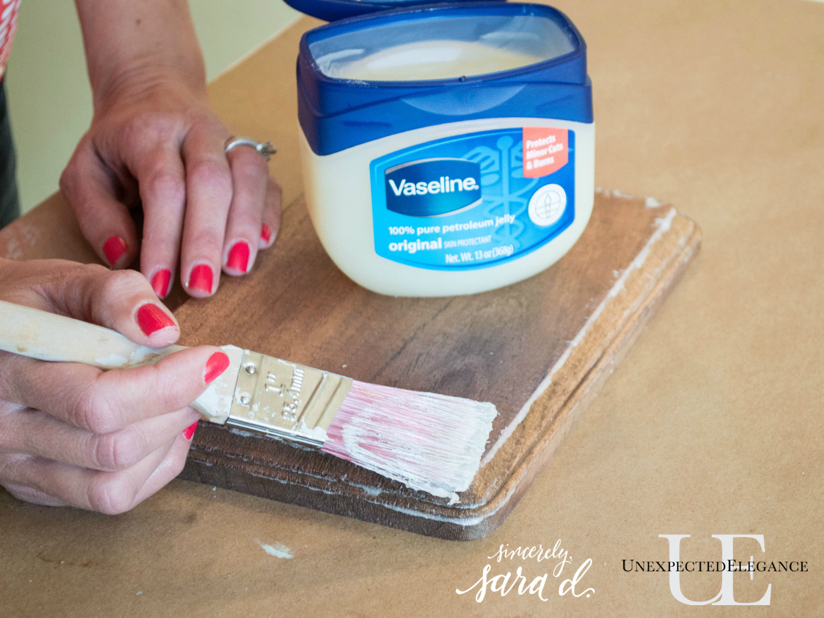 Want to easily distress a piece a piece of furniture?! Try this awesome and EASY technique using Vaseline.