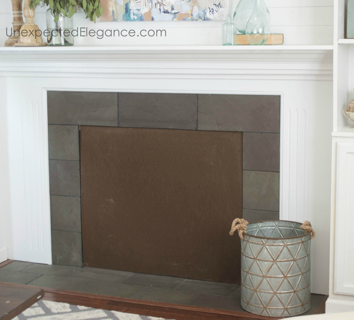 Stacked log fireplace insert tutorial...perfect for adding texture to your space.