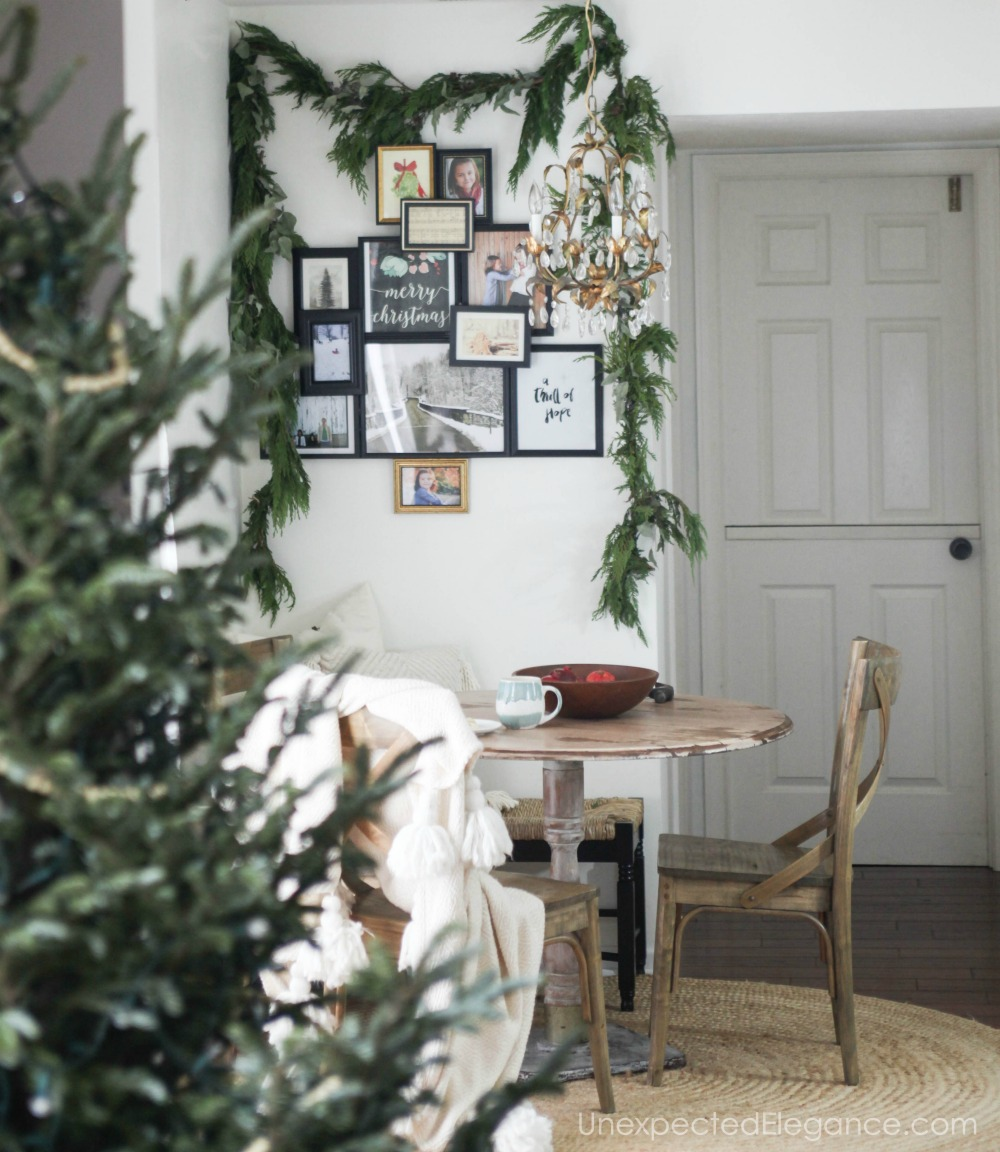Want to add some fun and personalized Christmas decor to your home this year? See how easy it is to create this sentimental holiday photo tree!