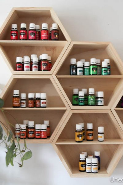 Need an organization system for your oils?? Check out this DIY essential oil wall storage system. It's not only functional but it's also pretty!