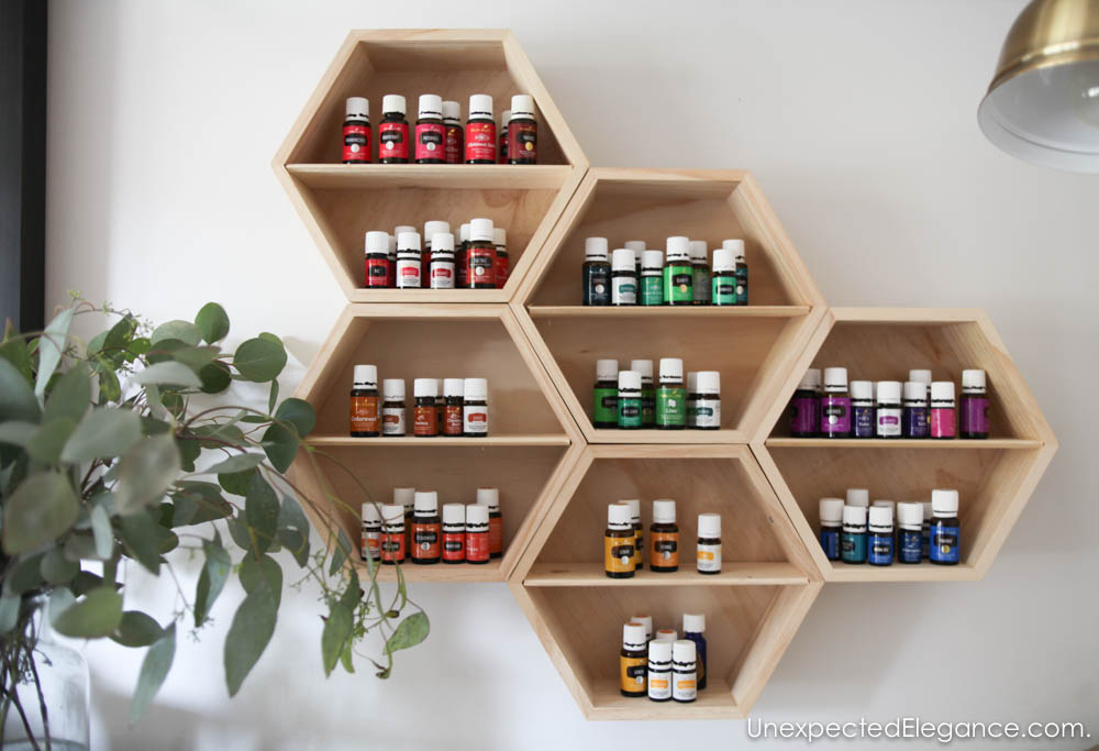 Need a pretty way to keep track of all your oils? Make this EASY DIY essential oil storage unit.