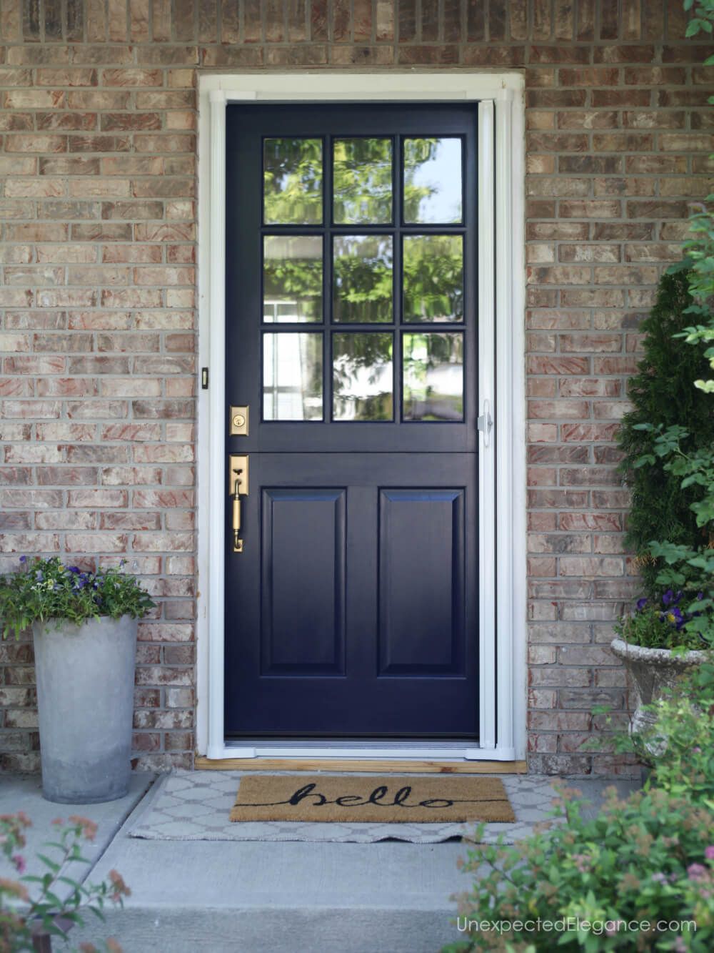 Dutch Door with retractable screen...genius! Check out this perfect solution for keeping the bugs out with distracting from the beautiful door.