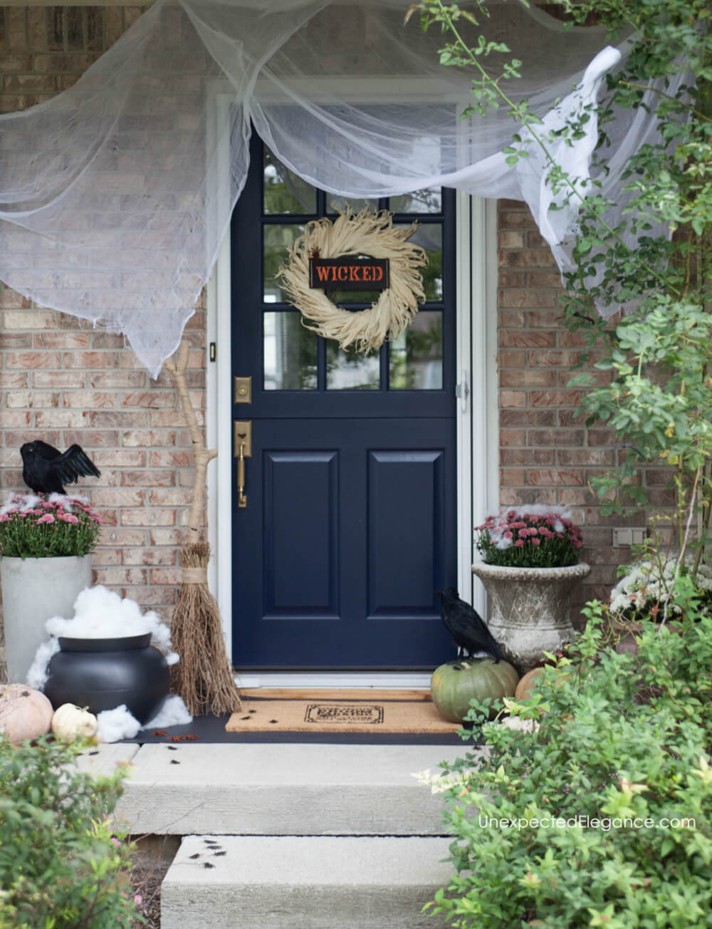 It's finally fall! Check out this porch decked out for Halloween with a WICKED theme!