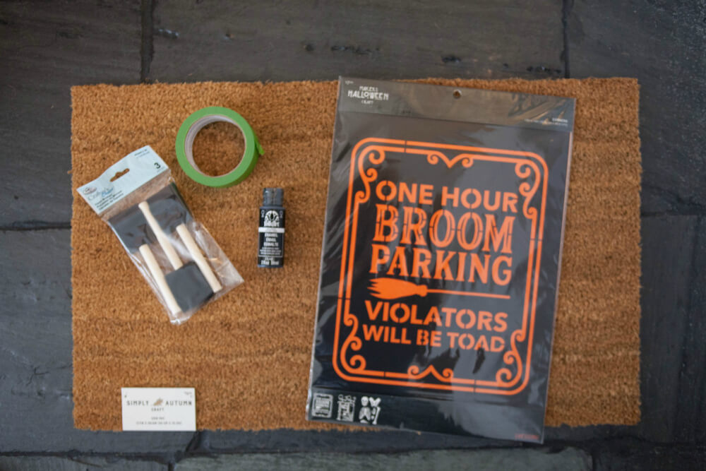 Supplies for DIY Halloween door mat.
