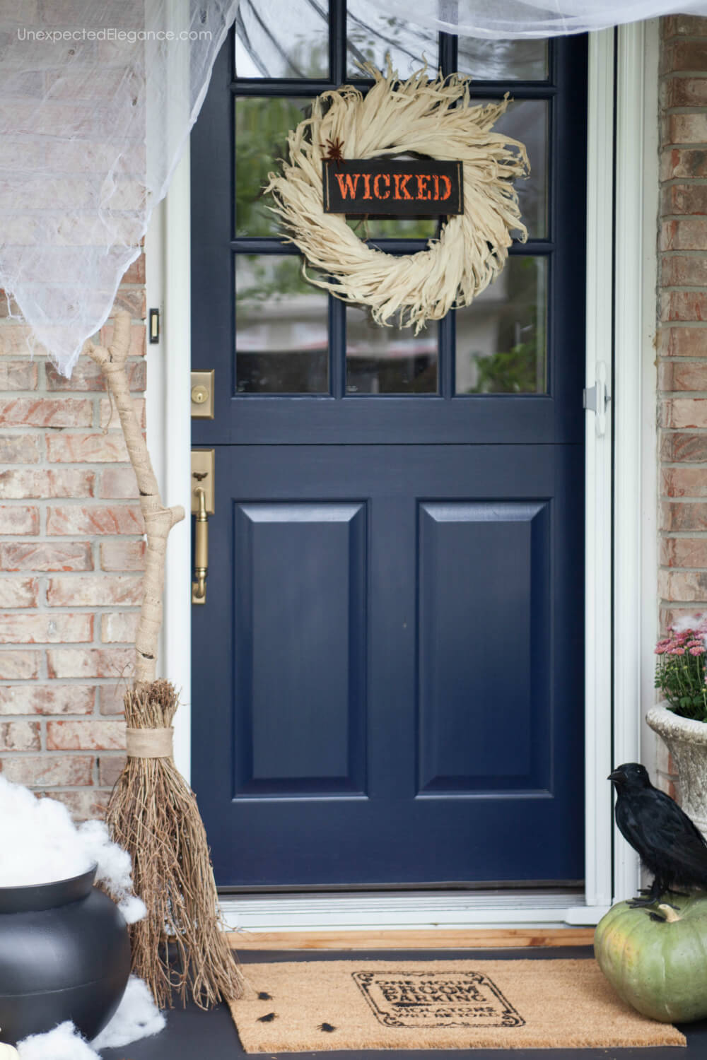 "It's finally fall! Check out this porch decked out for Halloween with a WICKED theme! Also get the tutorial for the cute doormat and ""smokey"" cauldron."