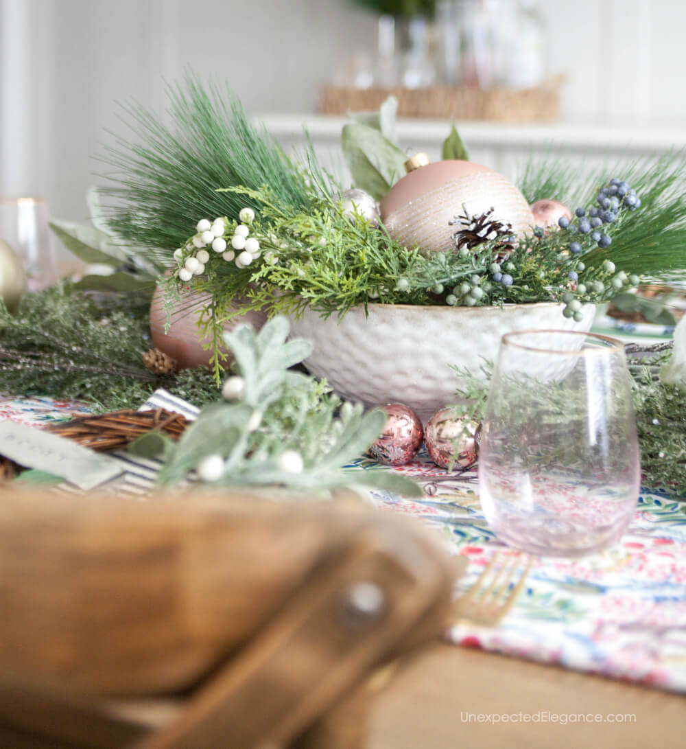 Can you believe this is faux greenery?  Get all the details for this easy and fun holiday table.
