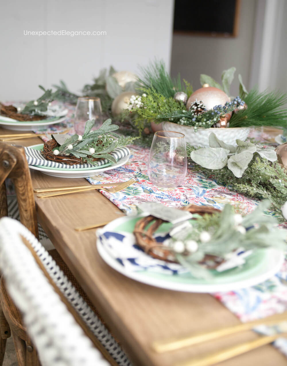 Here's a fun and festive holiday tablescape that super easy to put together.  Check out the non-traditional colors and get tutorial for a mini wreath your guests can take home.