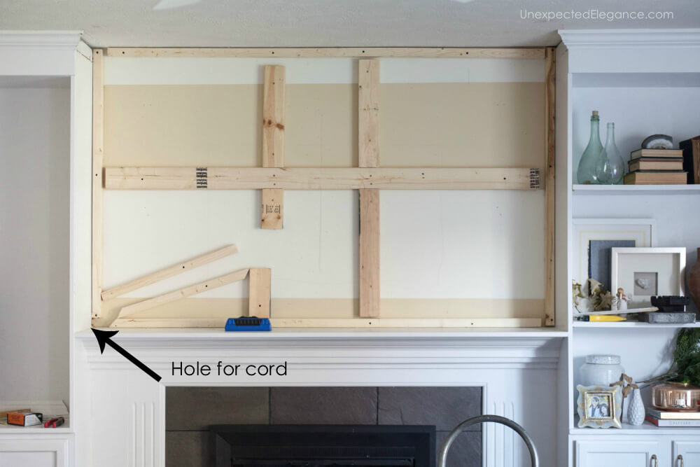 Check out this tutorial for hiding the TV cords above the fireplace.