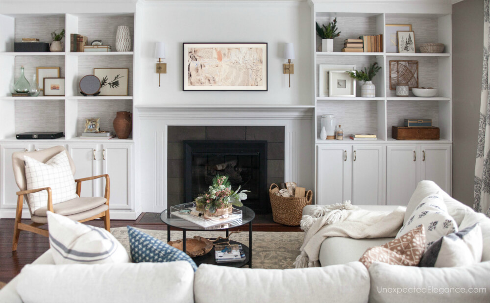That's a TV over the fireplace! See how to install a television over the fireplace and hide all the cords.