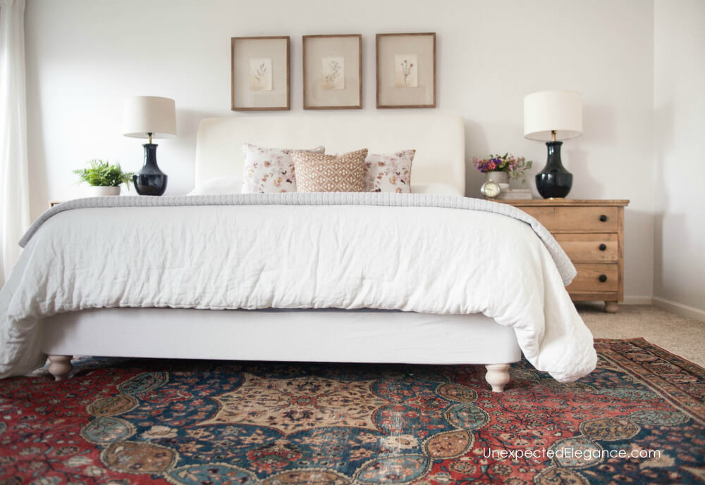This super simple DIY bed frame reupholstery transformed the look of this bed.